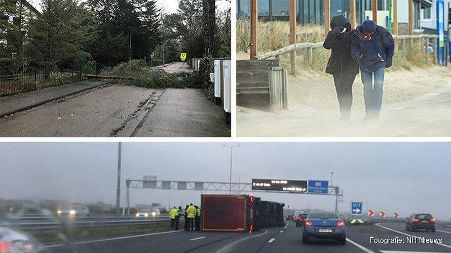Omgewaaide bomen, gekantelde vrachtwagens en code rood